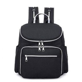 cf6103f7b Mochila mami con carga USB y bolsa de pañales para bebés y mochila de viaje  de