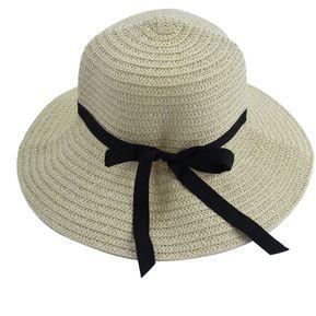 EW Gran sombrero de paja de color beige a lo largo de la playa 1f7a681e566f