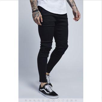 31997b7d63 Agotado Moda Pantalones De Mezclilla Con Agujeros Para Caballero Jeans  Hombre-negro